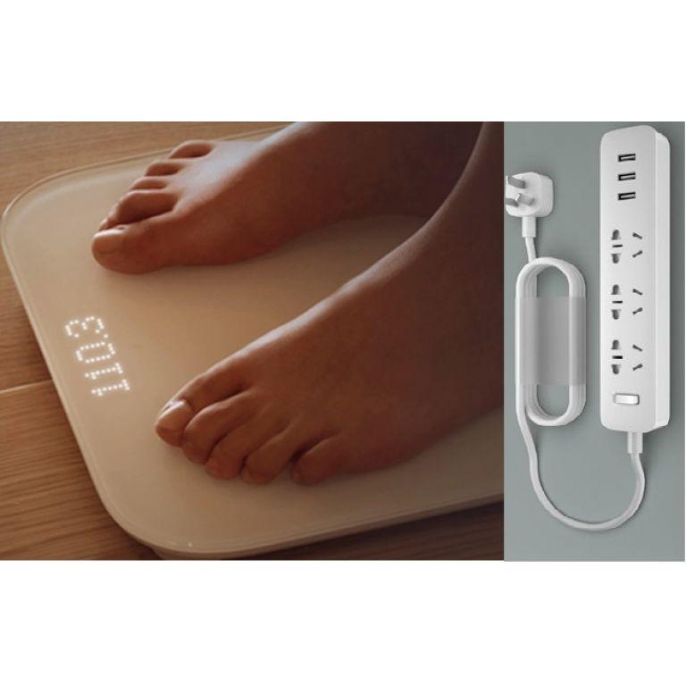 Una balanza inteligente y una zapatilla con enchufes y puertos USB de Xiaomi